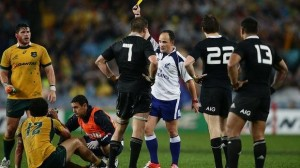 Referee Jaco Peyper gives a yellow card to Beauden Barrett of the All Blacks during the Bledisloe Cup opener