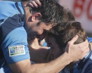 Uruguay players celebrate their Rugby World Cup qualification
