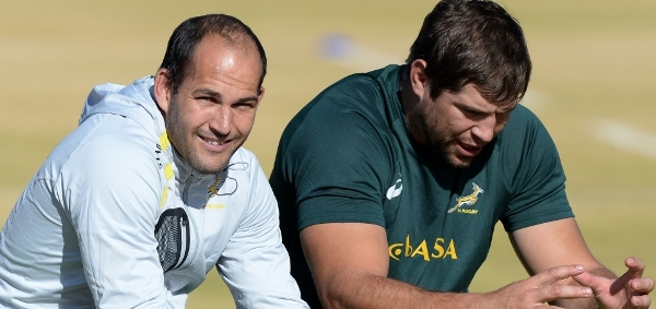 "Fourie du Preez and Willem Alberts sits on the sidelines as team mates train... part of the rather large ""Ambulance Squad"""